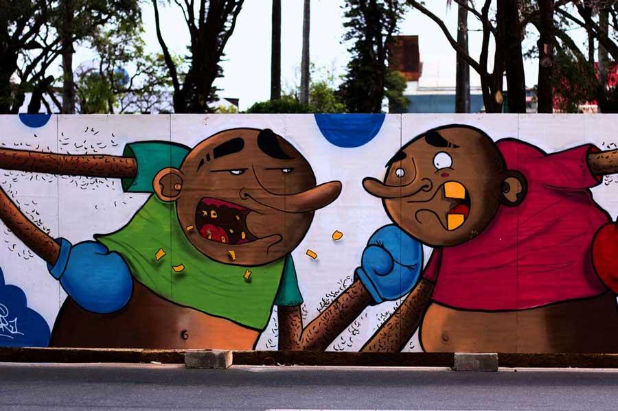 grafite nos tapumes da praça da Liberdade em BH